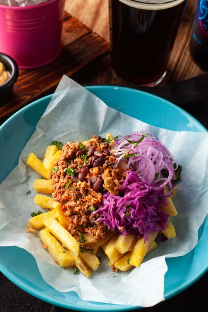 Super nutritious carne asada hot french fries with mexican-style salsa minced meat, red beans, red onion and coleslaw as a perfect beer snack