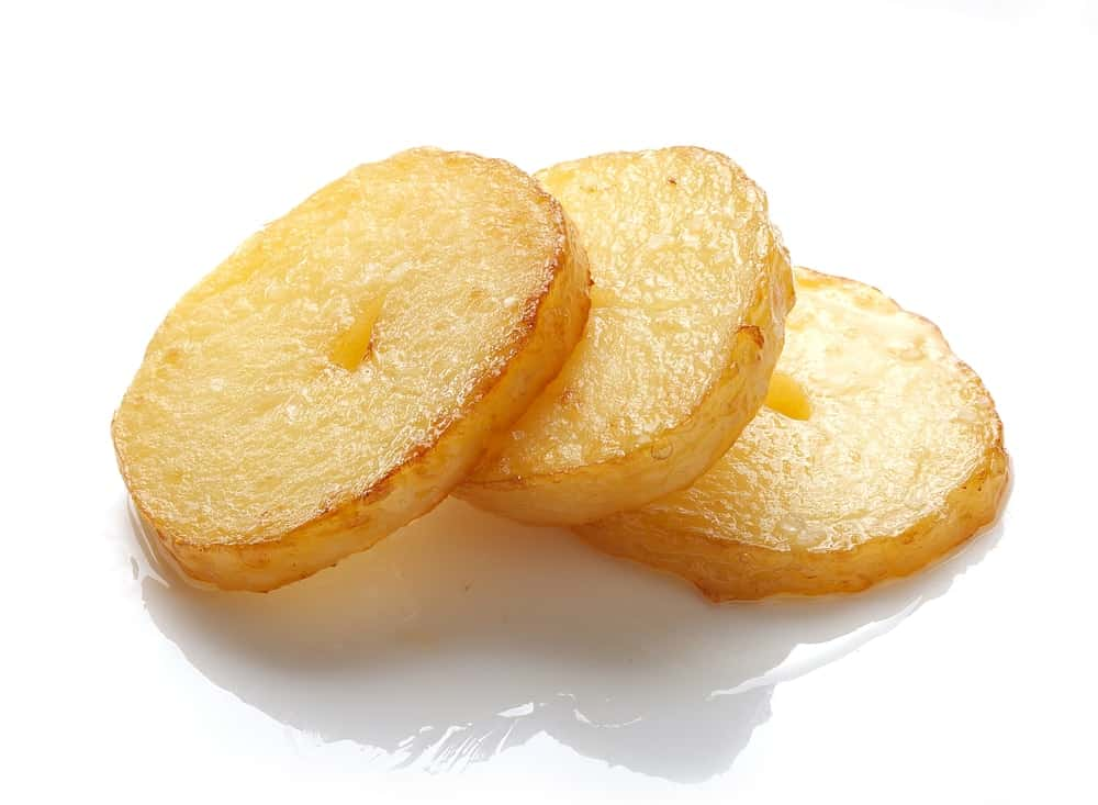 Three isolated fried pieces of potato on the white background.