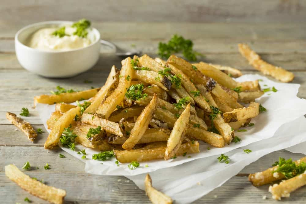 Homemade Parmesan Truffle French Fries with Parsley and Mayo.