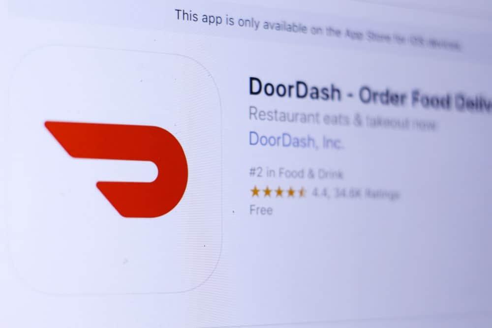 DoorDash logo and homepage on a digital screen.
