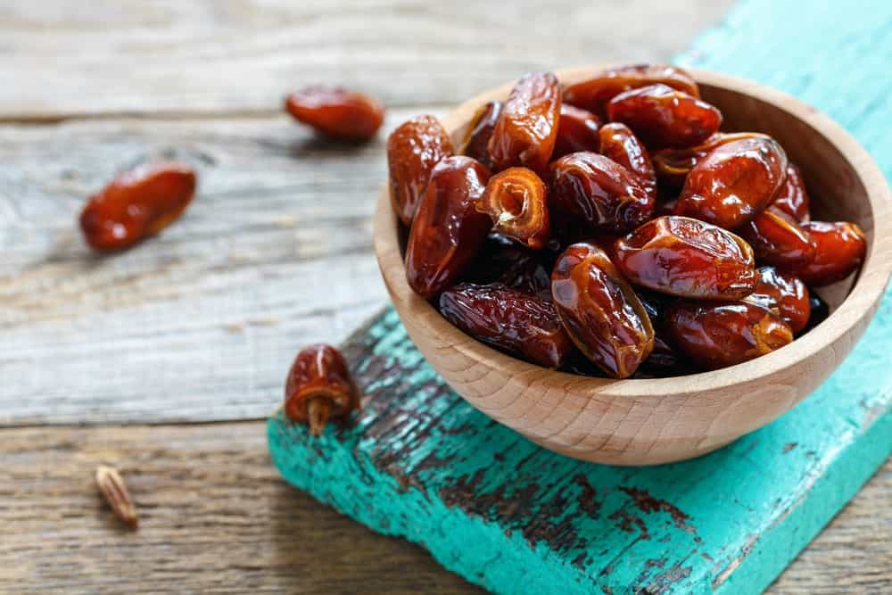 A wooden bowl of beautiful mouth-watering Dried Dates.