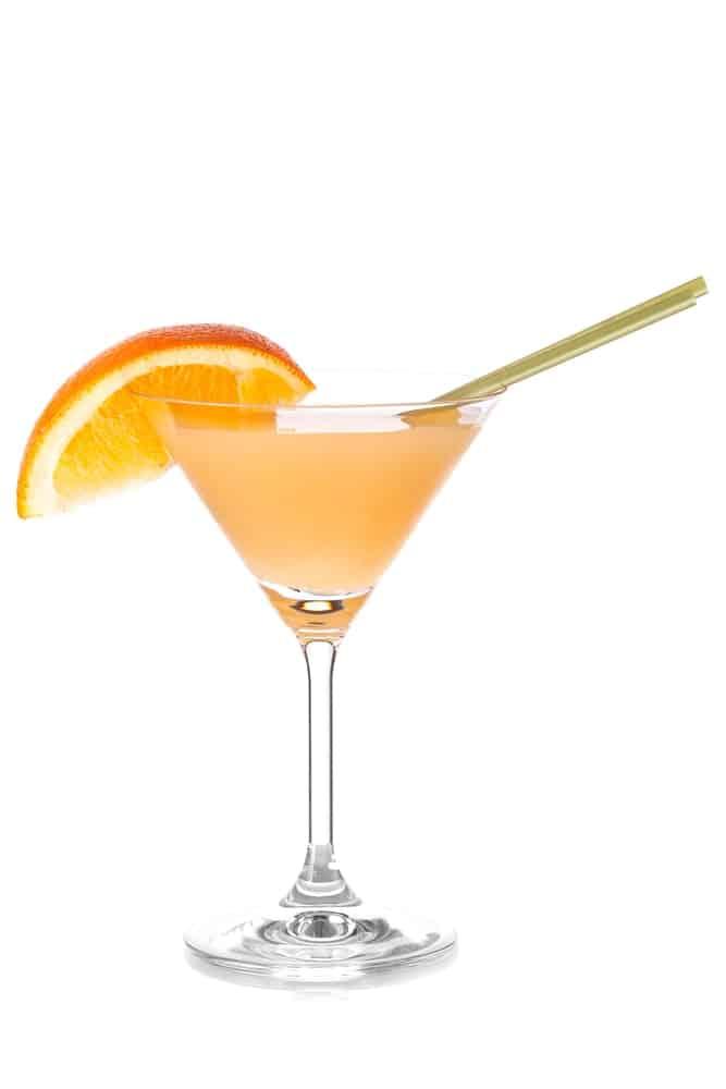 Bronx Martini garnished with orange wedge.