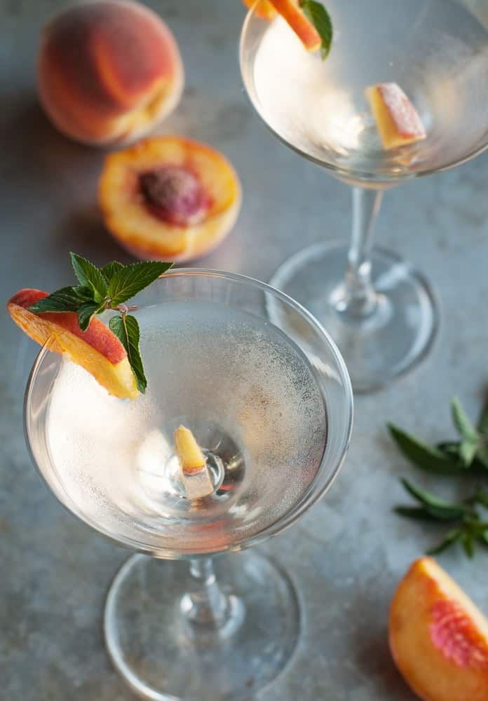 Fuzzy Martini garnished with peach slices.