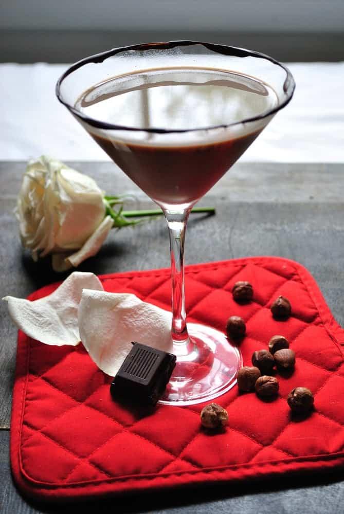 Chocolate hazelnut Martini with chocolate syrup garnish on the glass rim.