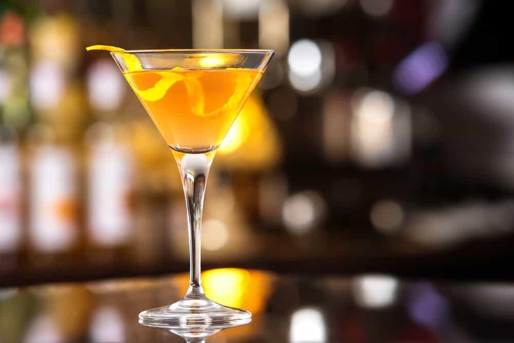 Inverted Pyramid Martini with orange peel.