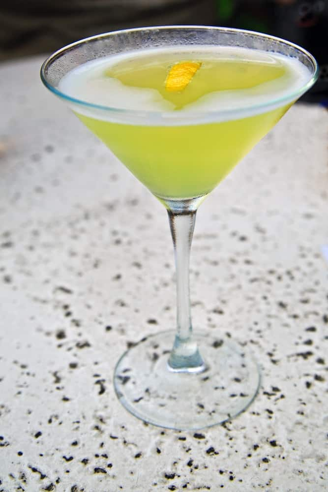 Pear Martini garnished with a lemon peel.