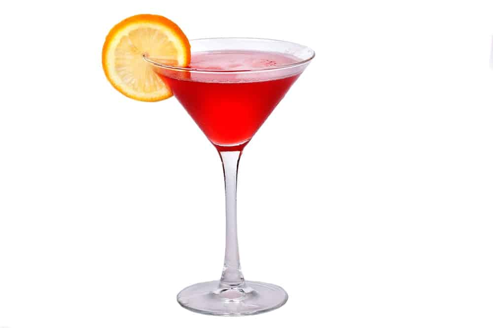 Red Vodkatini with a garnish of orange slice.