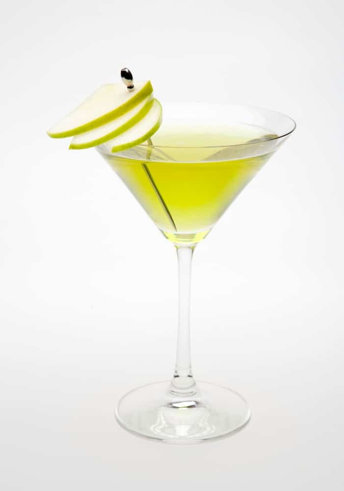 Sour Apple martini garnished with sour apple slices.