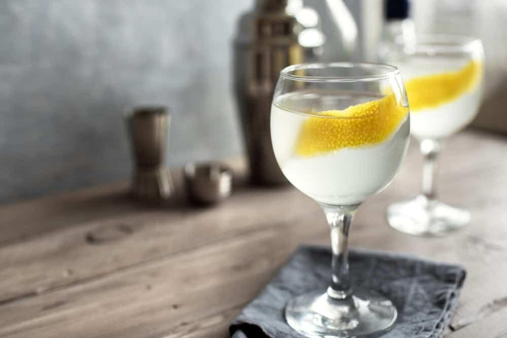Homemade Vesper Martini Cocktail with thick lemon peel.