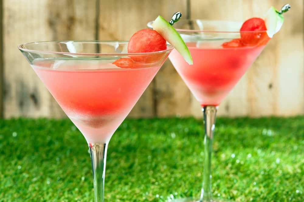 Watermelon Martini with balls of watermelon for garnish.