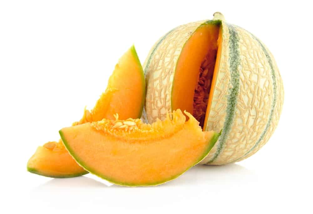 A sliced piece of Charentais Melon with a bright orange flesh.