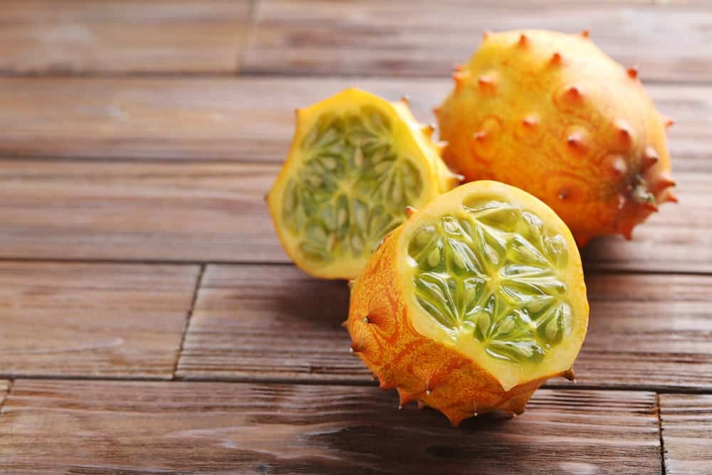 Kiwano Fuit or Horned Melon sliced with juicy insides exposed.