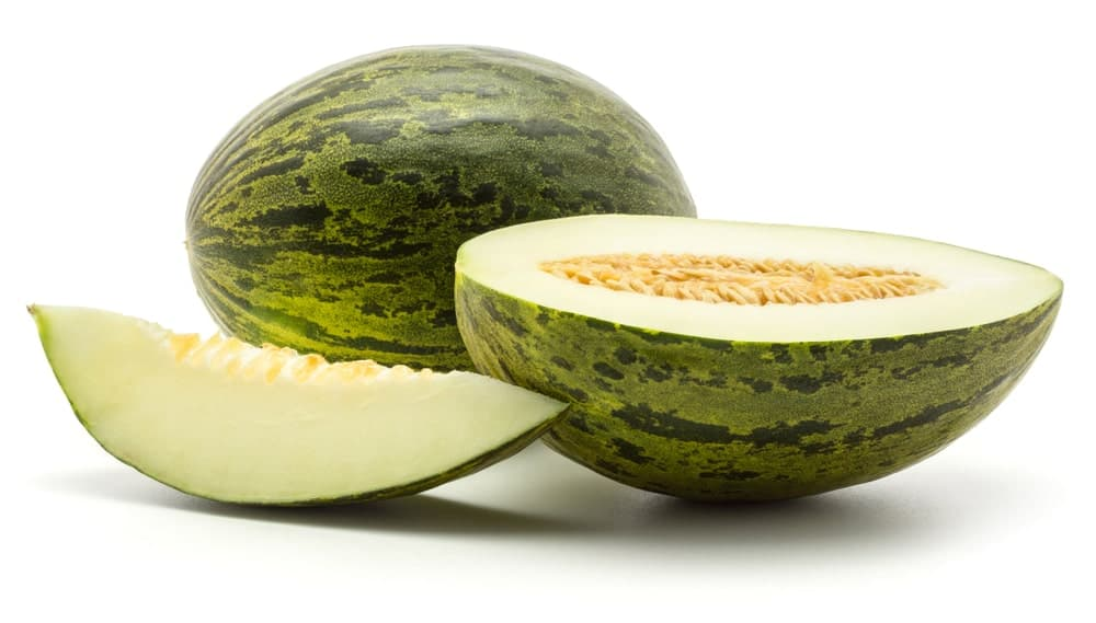 The white insides of a juicy Santa Clause Melon.