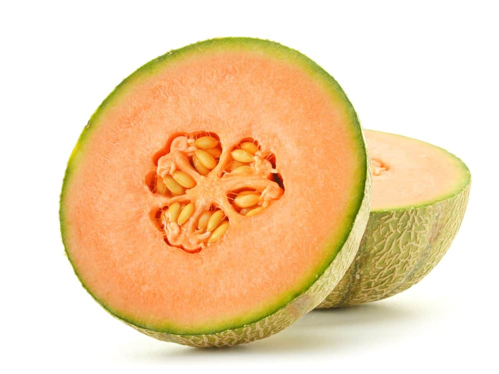A sliced piece of juicy and sweet Sugar melon.