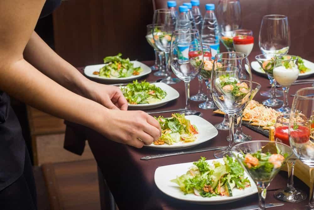 Waitress Setting a Table