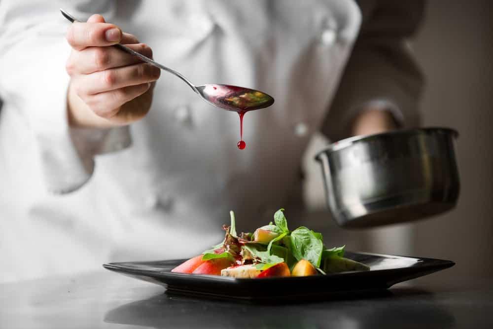 Chef preparing a dish.