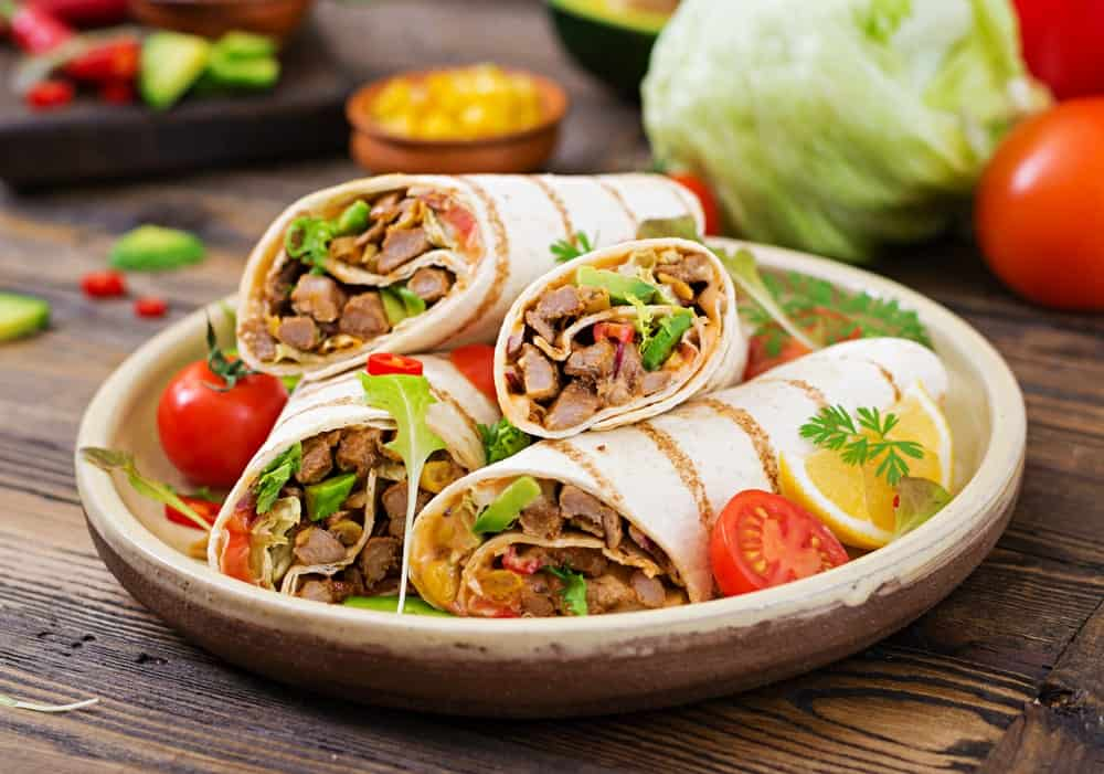 Burritos on a Wooden, Round Plate