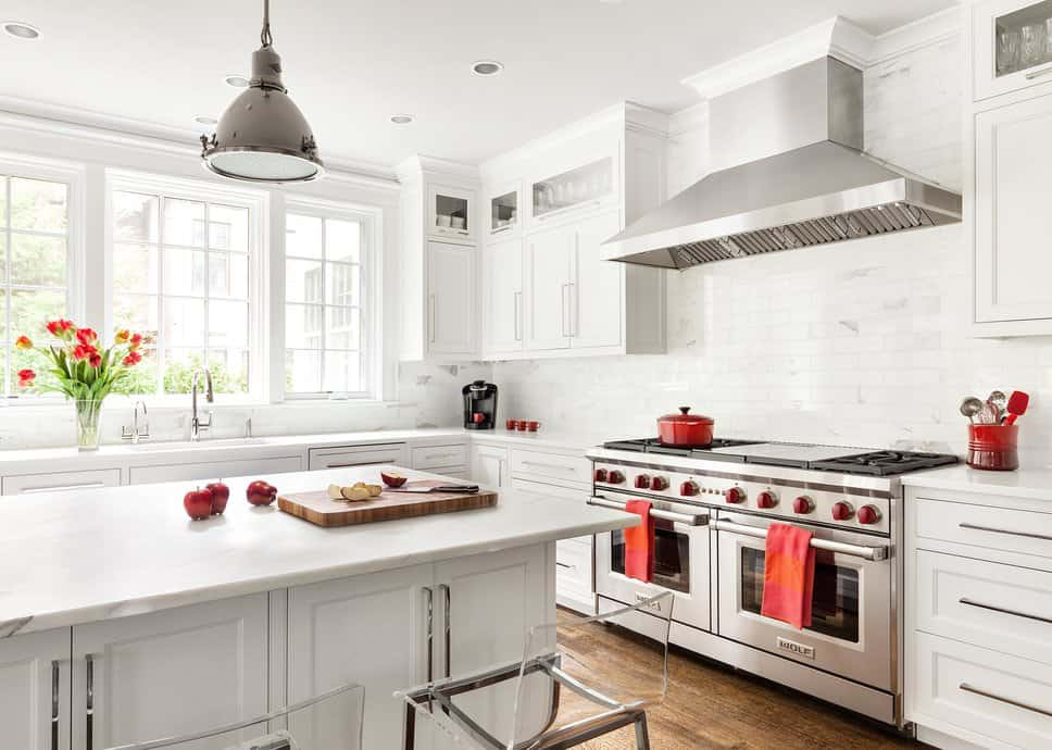 For an Asian kitchen, this one has a simple white and red color scheme. The entire kitchen looks wide and spacious especially with its all-white interiors, with the exception of the red accent on the stove switch, towels, cooking pans, and coffee mugs. The steel appliances such as the range hood and the double door oven also go well with the interiors. For some natural light, this kitchen has glass windows by the sink.