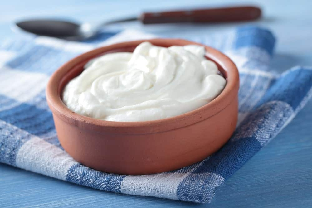 A small clay pot filled with yummy Greek Yogurt.
