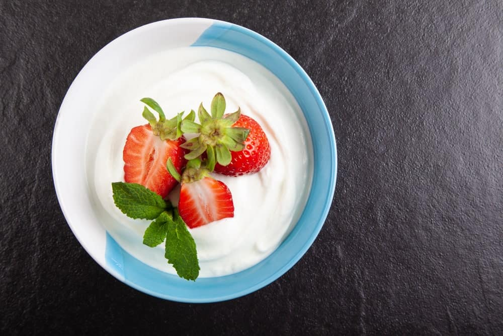 A delicious bowl of Icelandic skyr yogurt with strawberries added on top.