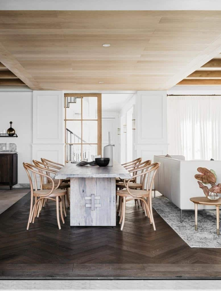 A dining area featuring hardwood flooring and a classy table along with stylish chairs.