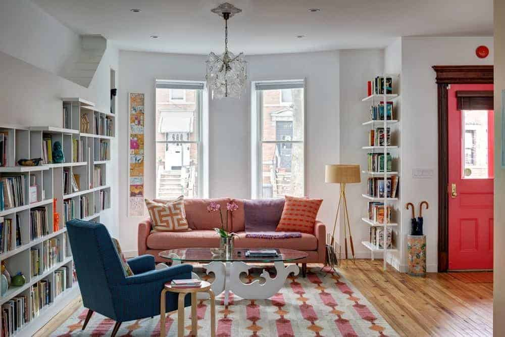 This living room is a place where book lovers will have a good time with those different bookshelves and a comfortable couch set.