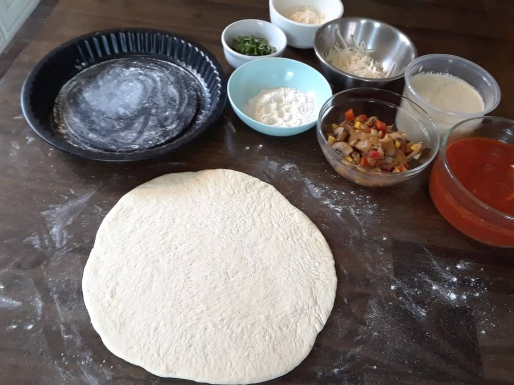 Flattened dough and ingredients.