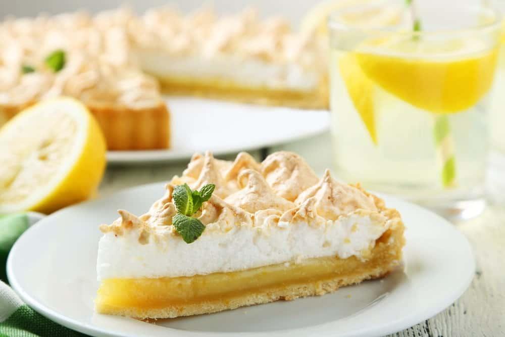 A slice of frozen lemonade pie with meringue.