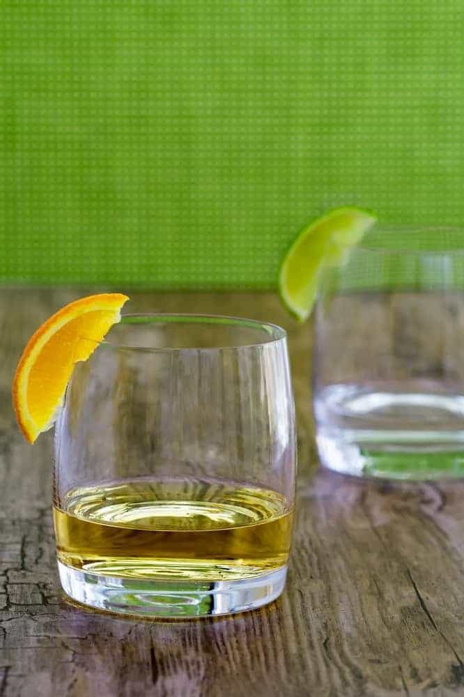 A close look at a shot of Añejo tequila in a whiskey glass.