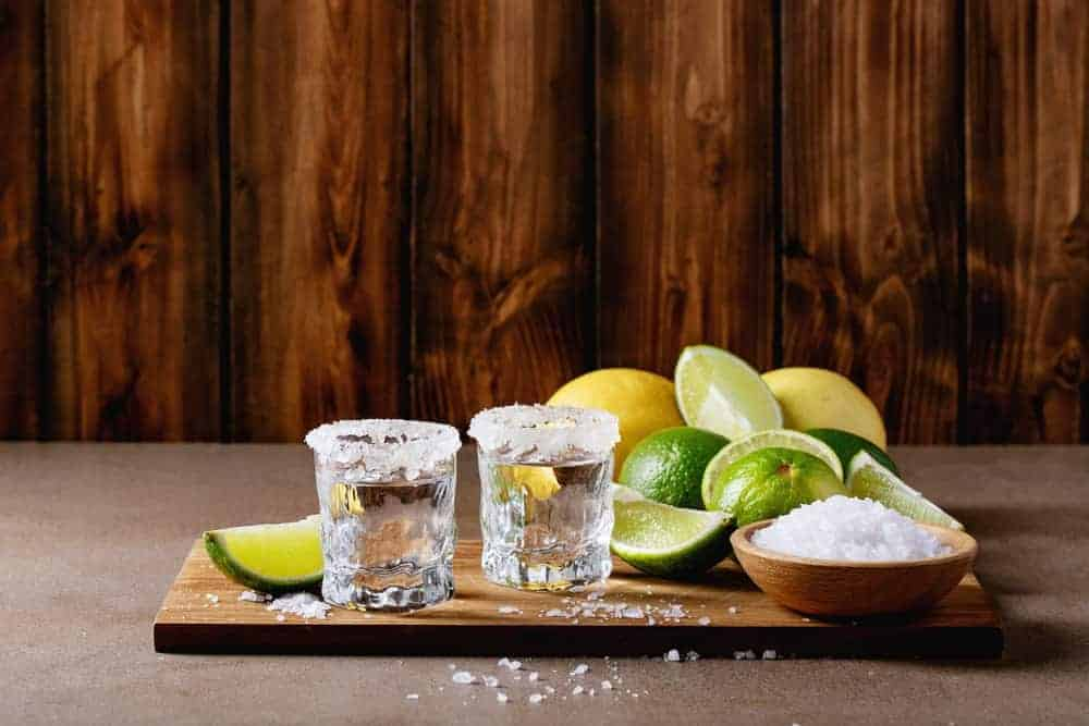 A couple of tequila shots with salt and lime.