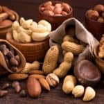 A table filled with the various types of nuts.