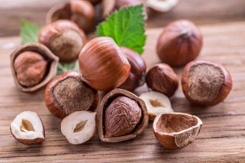 Hazelnuts on a cutting board.