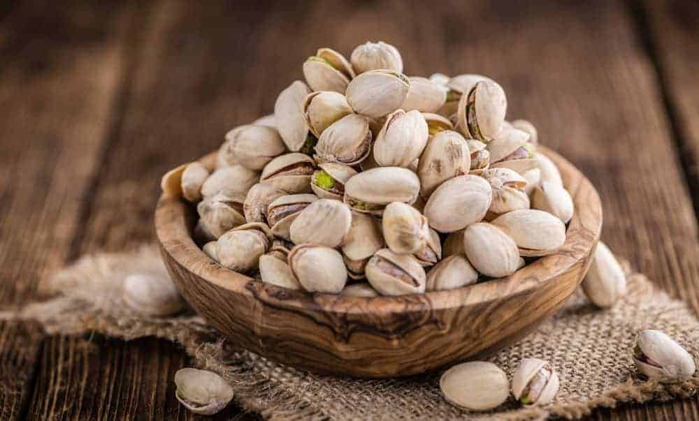 Bowl of pistachio nuts in the shell.