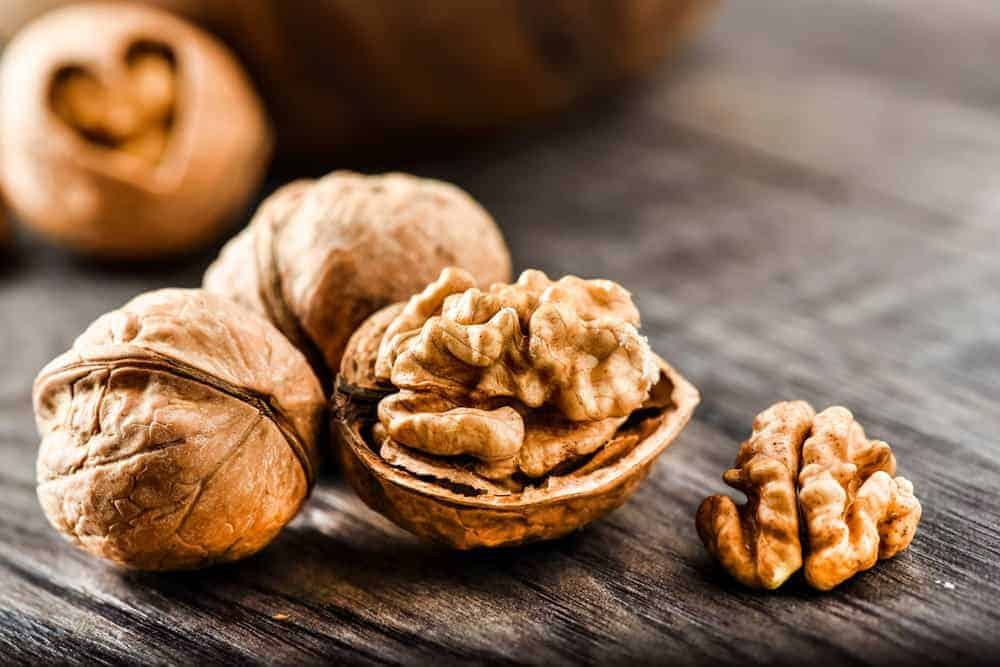 A close look at a few shelled walnuts.