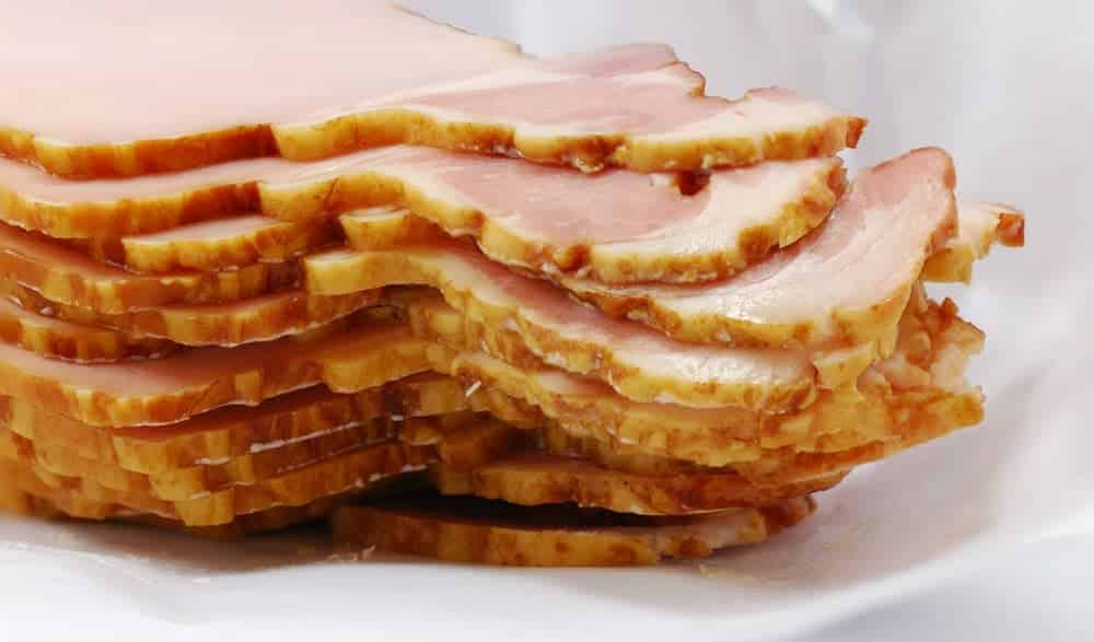 A close look at a stack of Canadian bacon.
