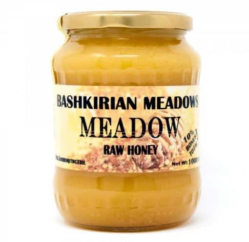 A jar of Bashkirian Meadows Meadow Raw Honey.