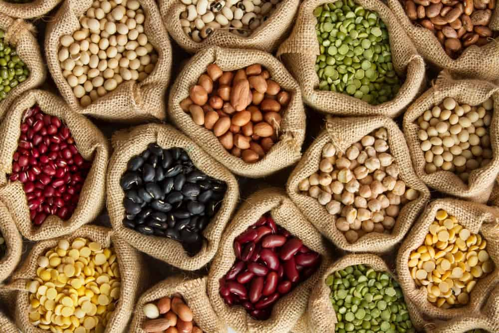 Various beans and legumes in rustic sacks.