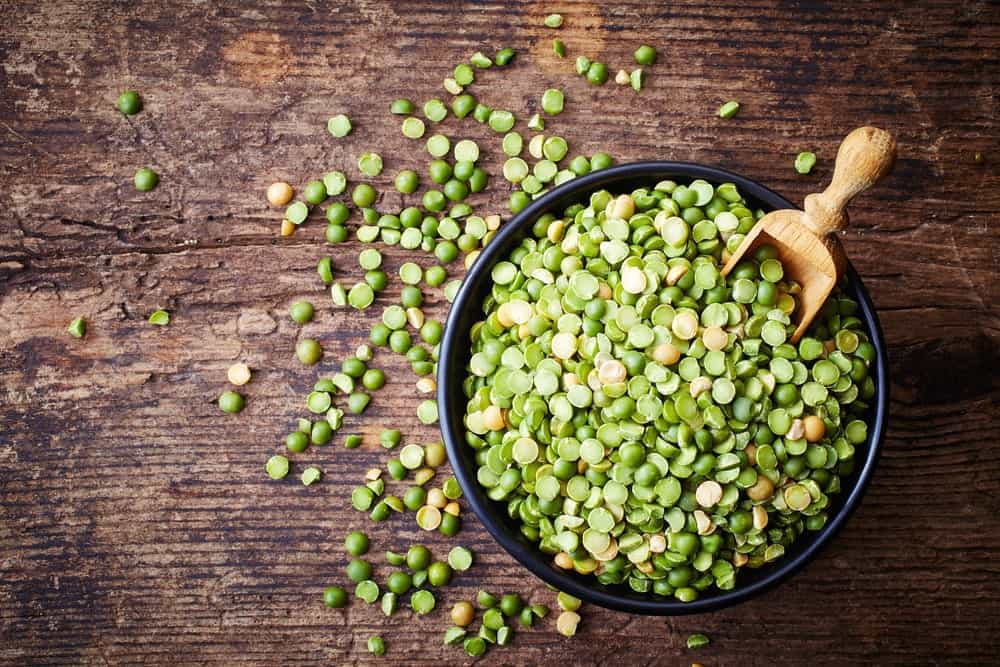 A look at a bowl of green and yellow split peas.