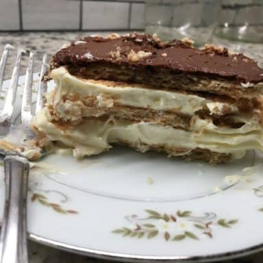 A slice of chocolate eclair cake on a plate.
