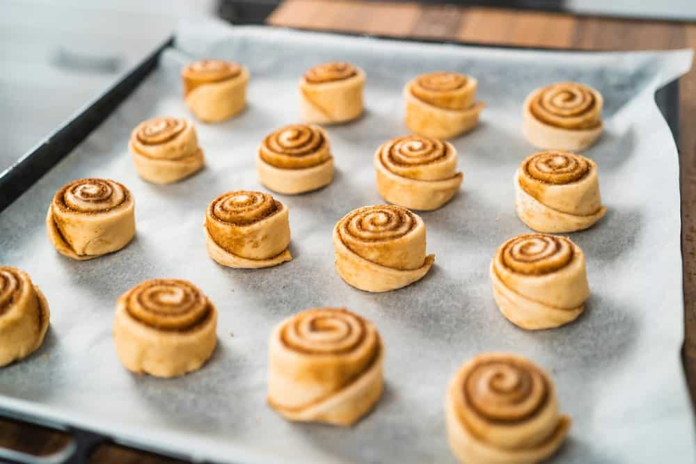 This is a pan of rich dough cinnamon swirl pastries ready to be baked.