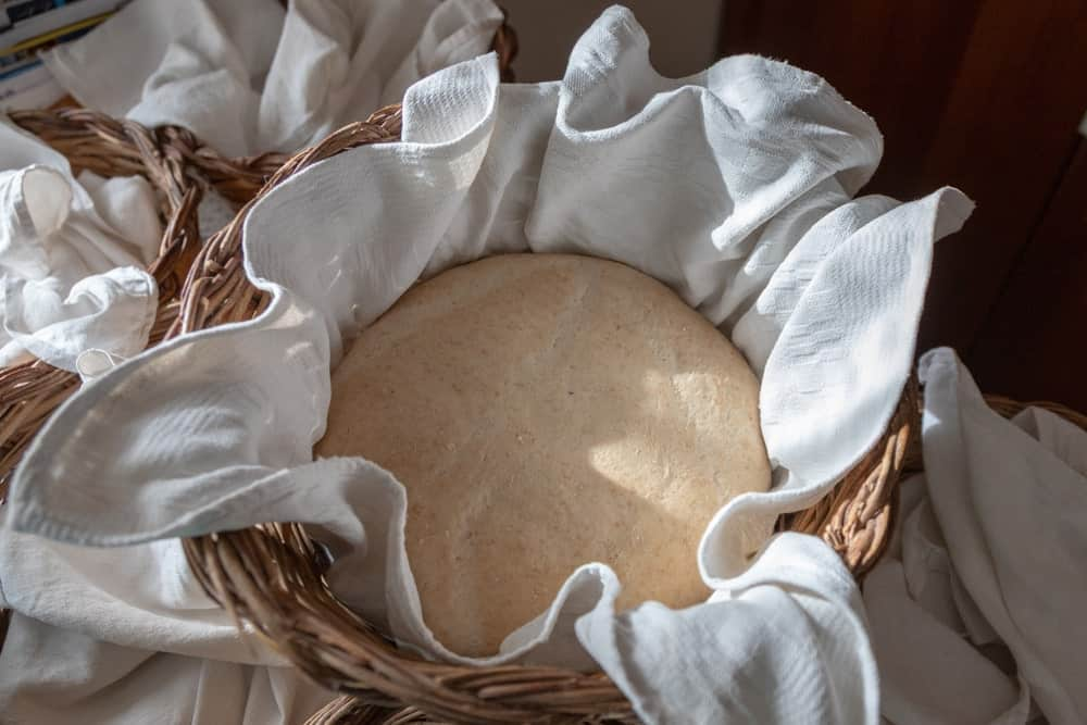 This is a large leavened dough in a basket covered with a dish towel.