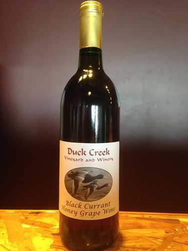 A bottle of black currant mead from Duck Creek Wine.