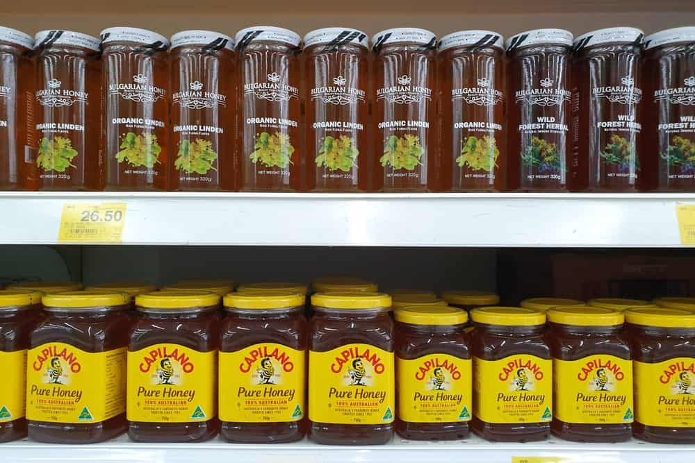 Jars of pure honey on display at the supermarket.