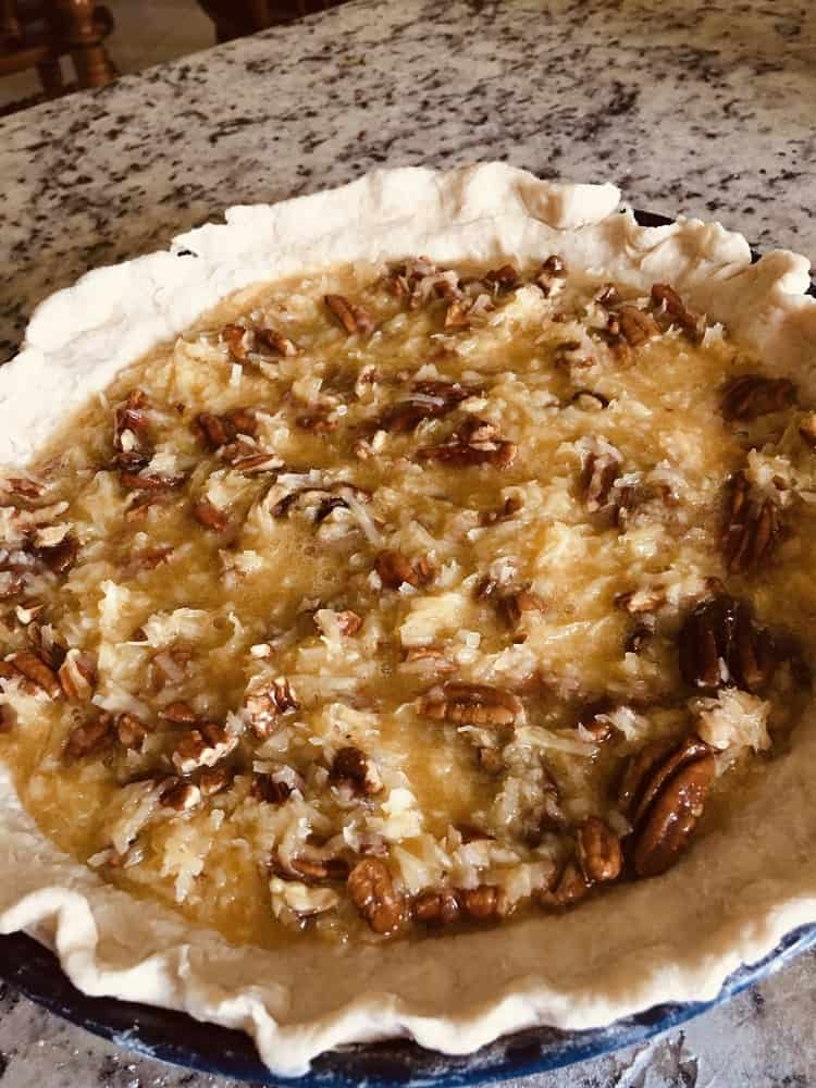 The filling is poured onto the pie crust.