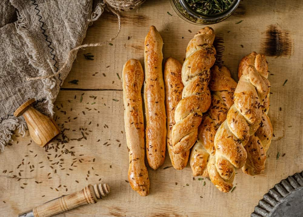 A bunch of freshly-baked garlic and herb bread sticks.