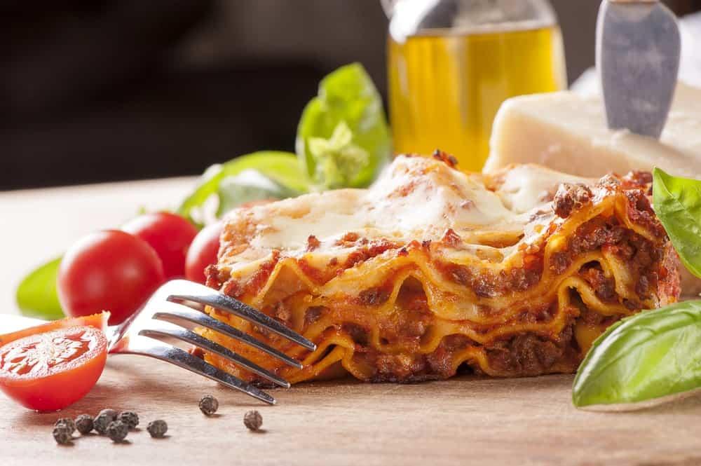 A close look at a fresh slice of homemade lasagna.