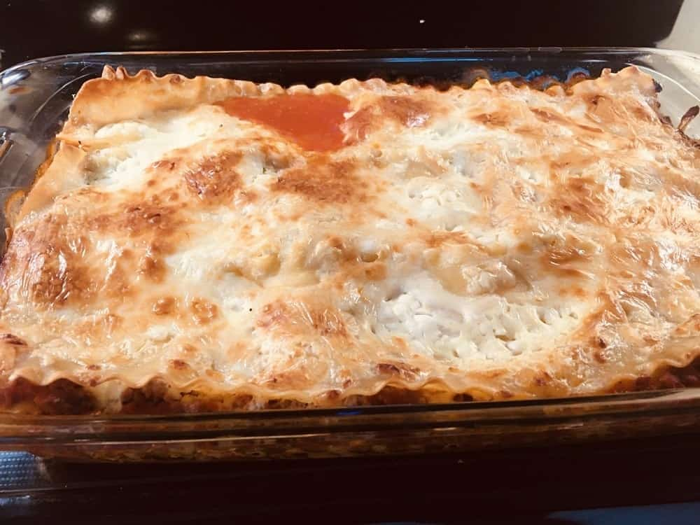 The lasagna is taken out of the oven.