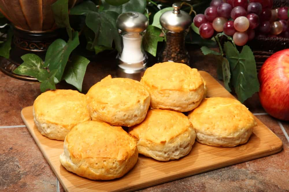 Freshly-baked Southern biscuits on a chopping board.
