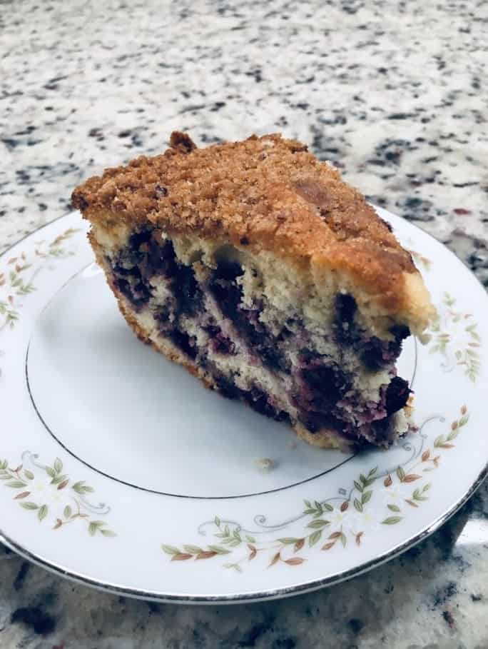 A slice of freshly-made lemon blueberry coffee cake.