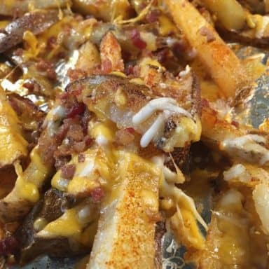 A close look at freshly-baked loaded potato wedges.